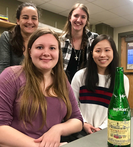 Undergrads smiling with bottle